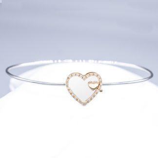Bracciale in oro e diamanti doppio cuore